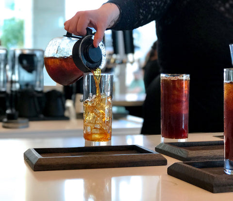 Pouring cold brew into glass at Parisi