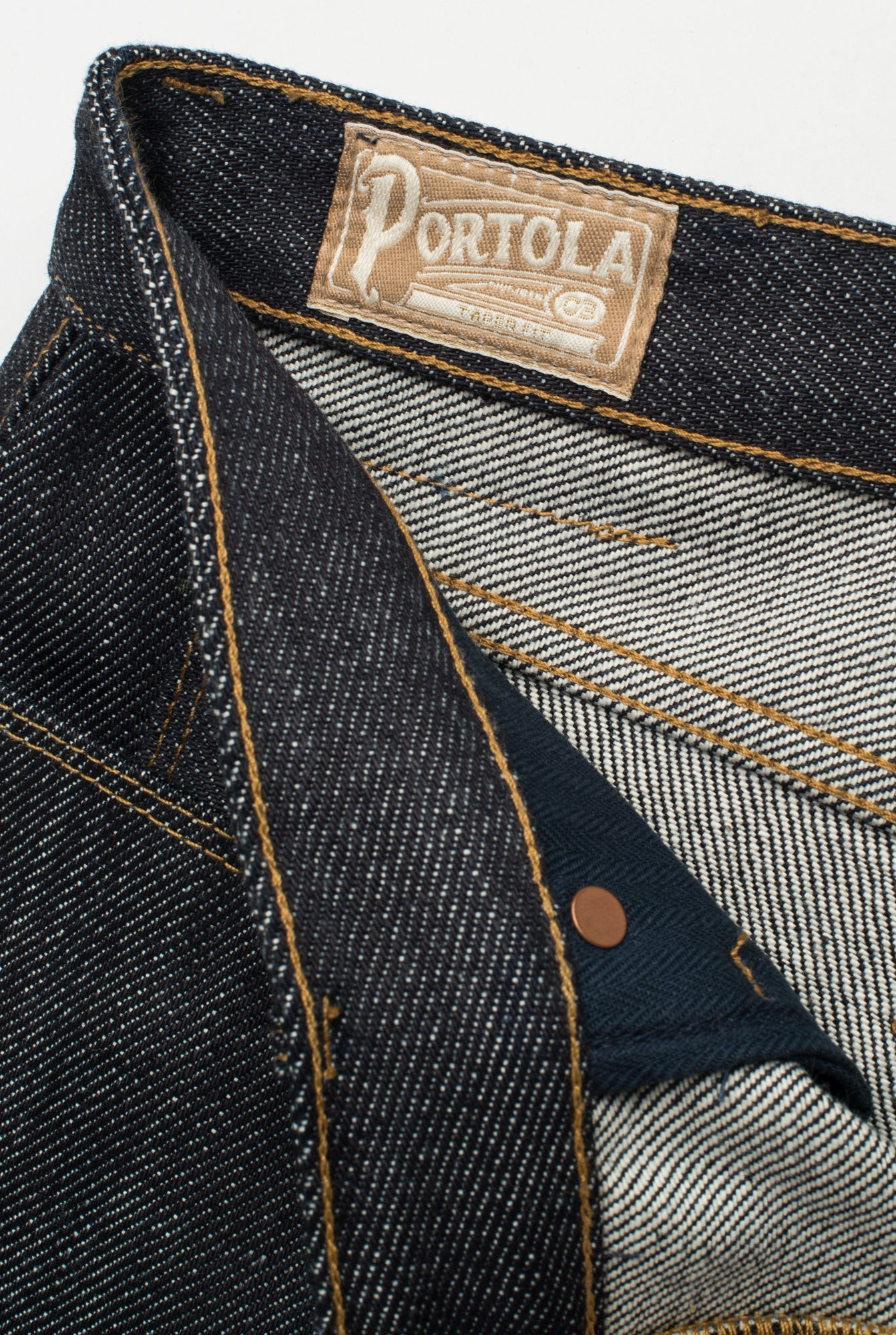 Portola Taper Raw 20 oz Japanese Denim tag