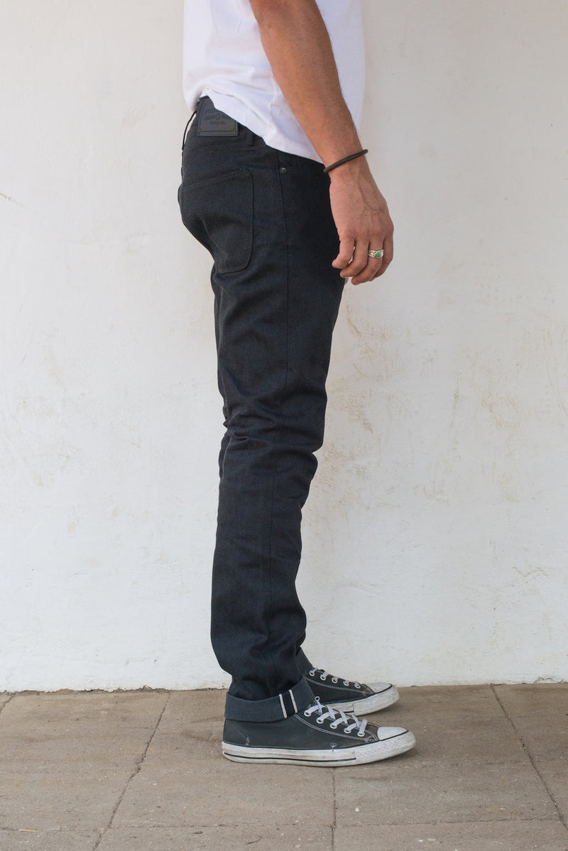 Avila Slim Taper - Raw 14.25 oz Black Grey Denim On Model Right Side
