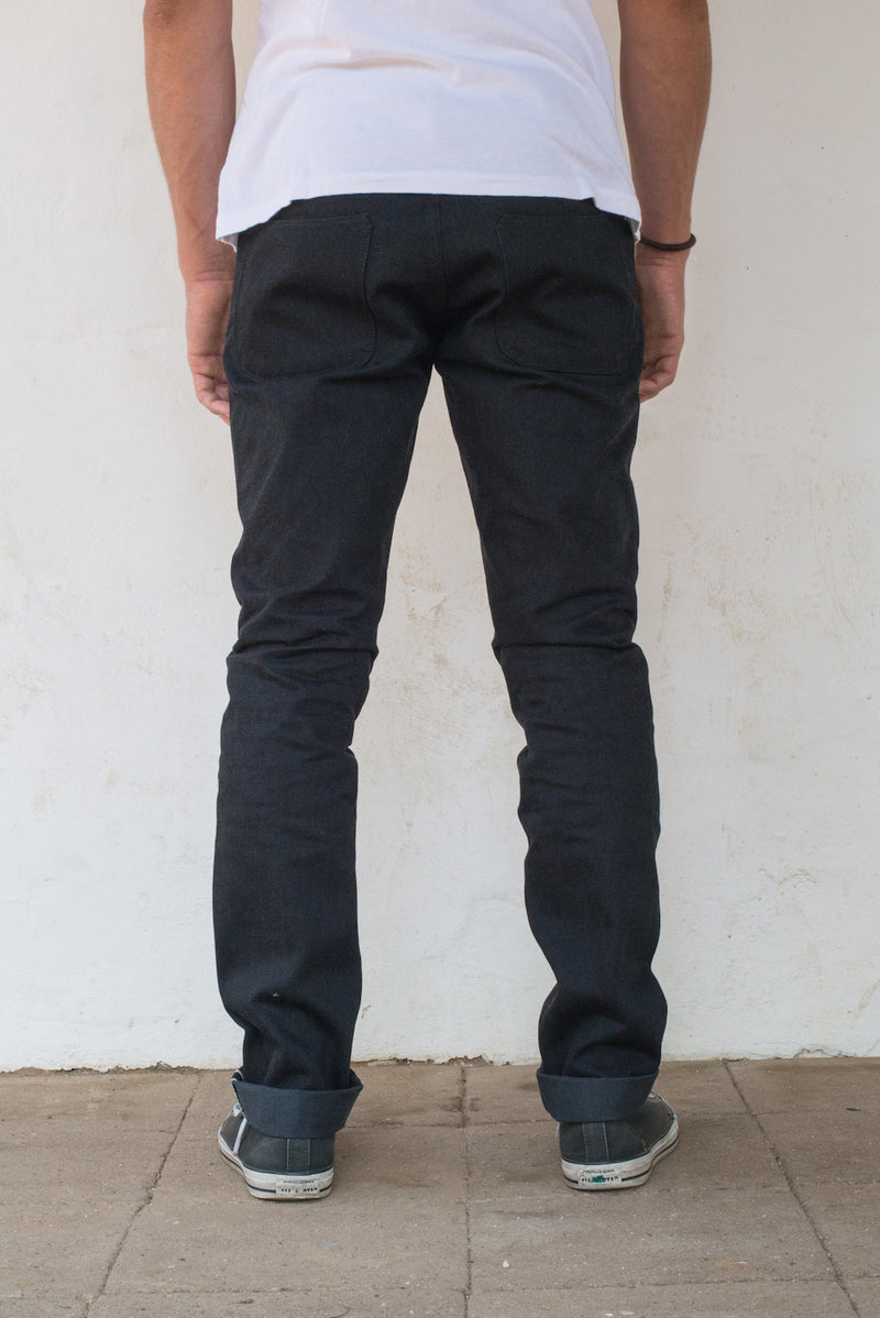 Avila Slim Taper - Raw 14.25 oz Black Grey Denim On Model Back Side