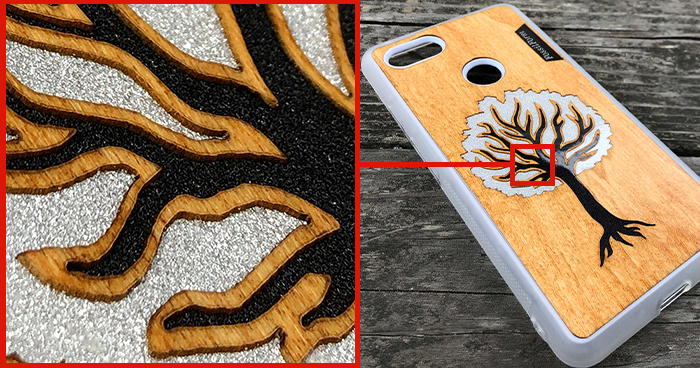 Magnified image of a wood + resin phone case