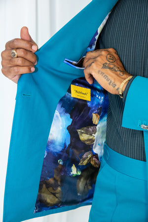 Teal double breasted suit with tonal striped detail