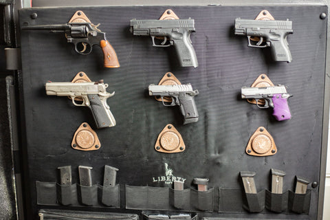 Guns mounted on a wall with a SofHold magnet mount