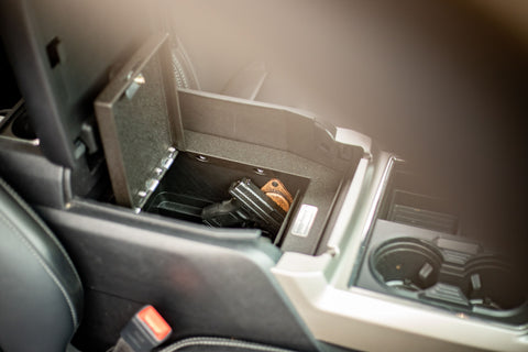 SofHold gun magnet mounted in center console of a car