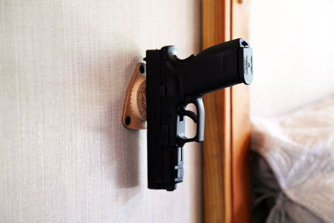 Gun mounted on the wall with SofHold gun magnet mount