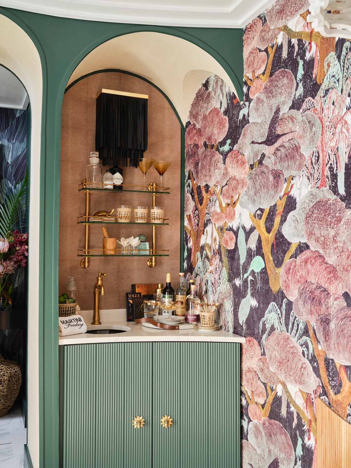 Indoor Pool Bar Design with Patterned Wallpaper, Green Cabinets & Brass Hardware