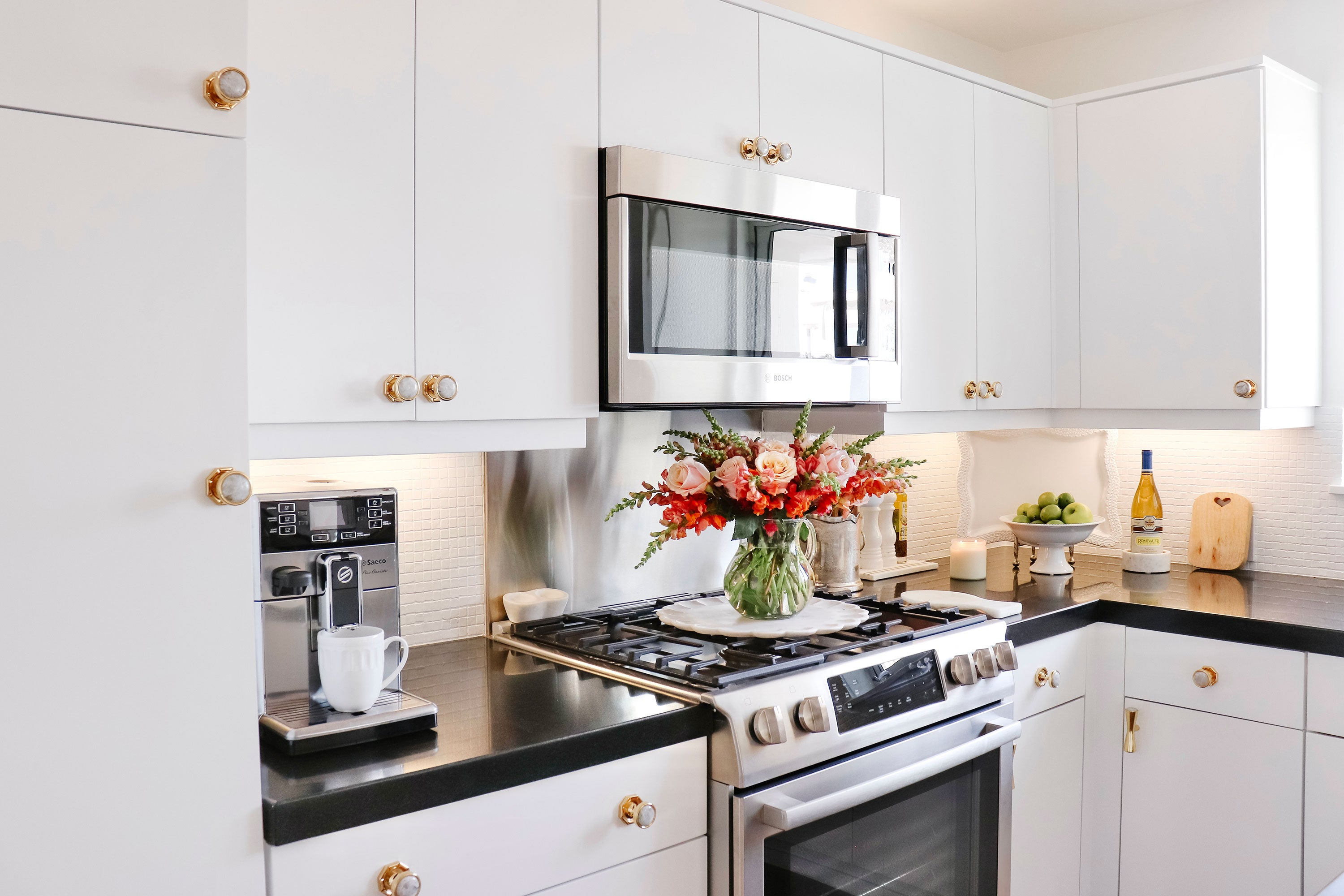 White Kitchen Cabinets with Brass Bamboo Backpate & Lane Knob with Moonstone