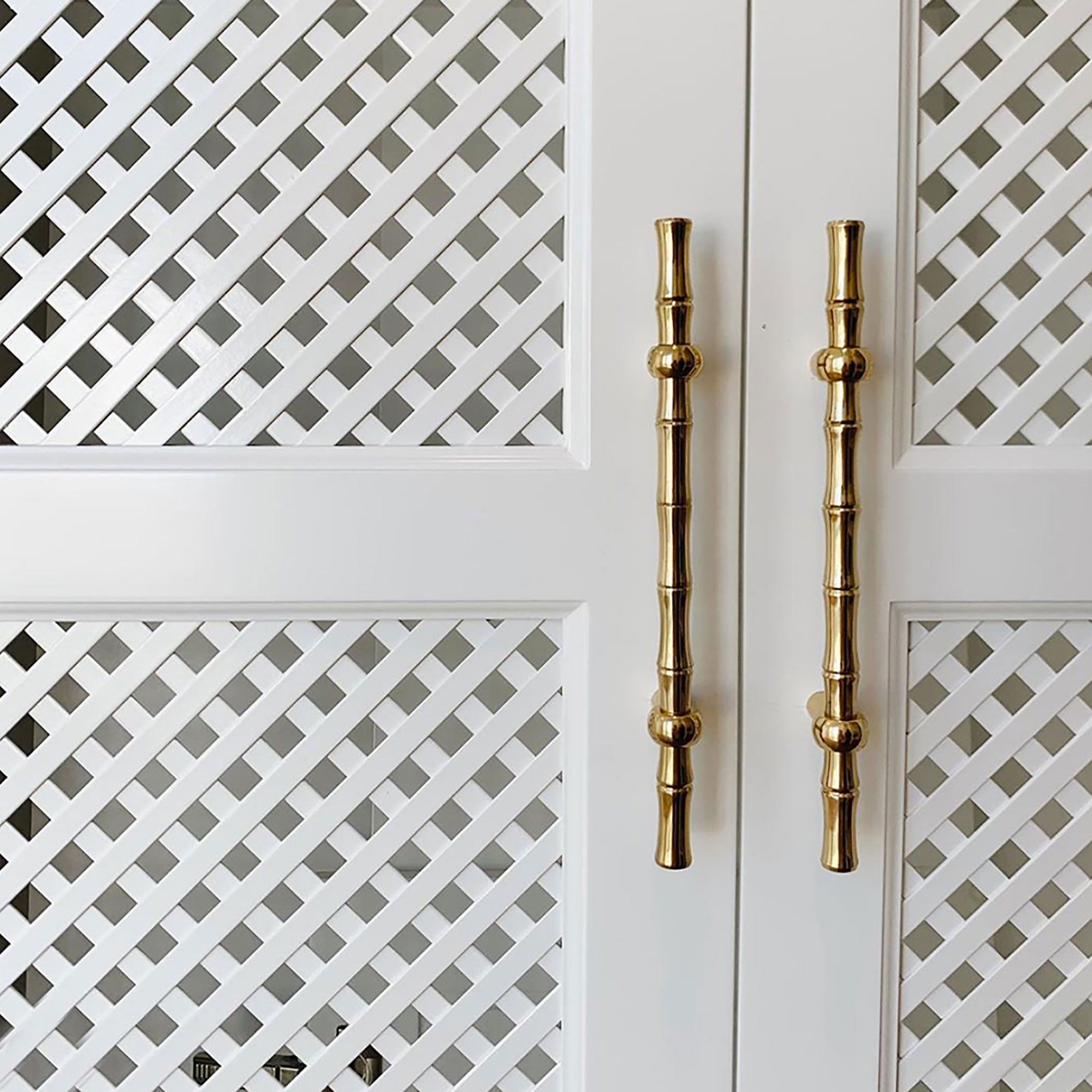 "Made from 100% solid brass and available in three finishes, this design has been featured in House Beautiful and Luxe Magazine. This 10"" pull is mostly used on large cabinets, doors, and appliances. bamboo brass handle"