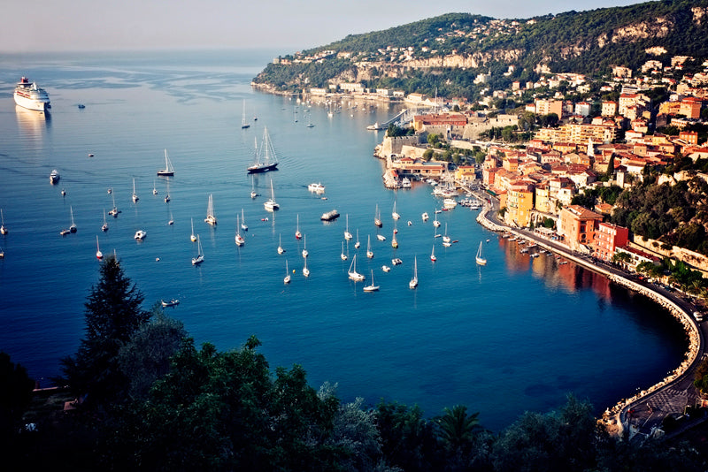 The stunning view of the bay of Villefranche sur Mer and the village beyond in the early morning light