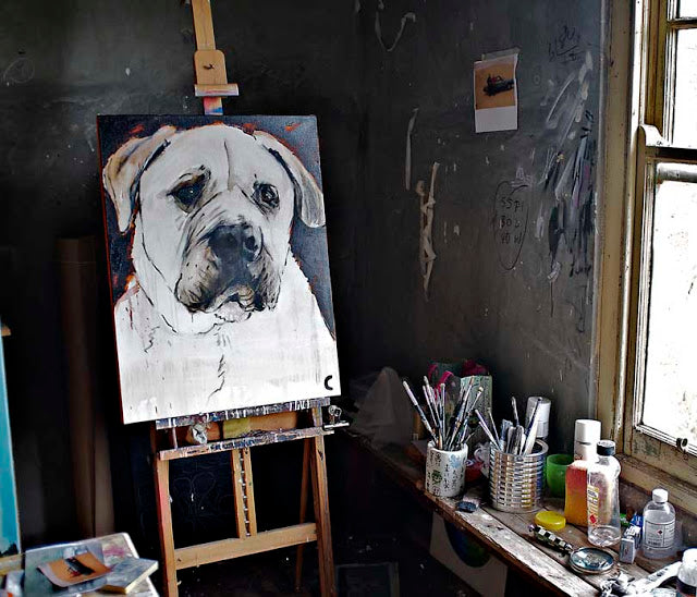 Cassie Thring's painting of Hugo the dog sits on the easel in her studio