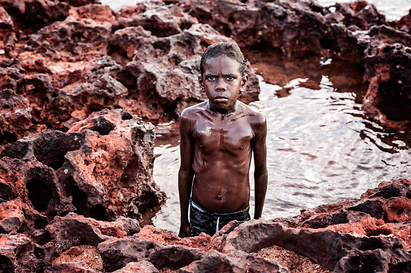 A Moment Millie Brown's finalist National Photographic Portrait Prize 2017 image of Yolngu boy Peter Brown in a rock pool at Nyinyikay homeland in East Arnhem Land