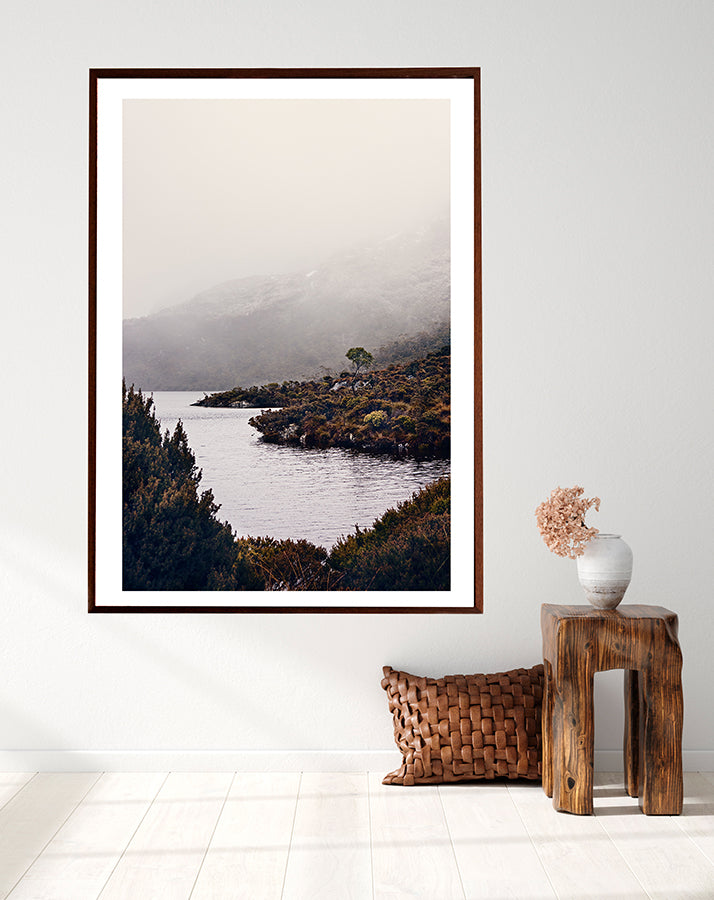 Cradle Mountain fine art print featuring Dove Lake in the Cradle Mountain National park Tasmania surrounded by bushland and low winter cloud shot by Millie Brown