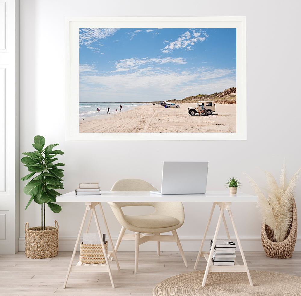 Australian beach wall art featuring long beach robe with its land rovers parked on the sand on a hot summer day fine art print by photographer millie brown
