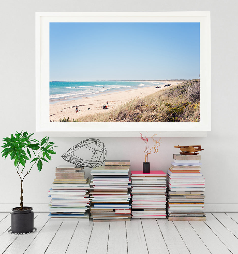 Long Beach robe print featuring the grassy sand dunes and the acquamarine ocean with people and cars on the white sand and a big blue sky. Limited edition fine art print by Millie Brown