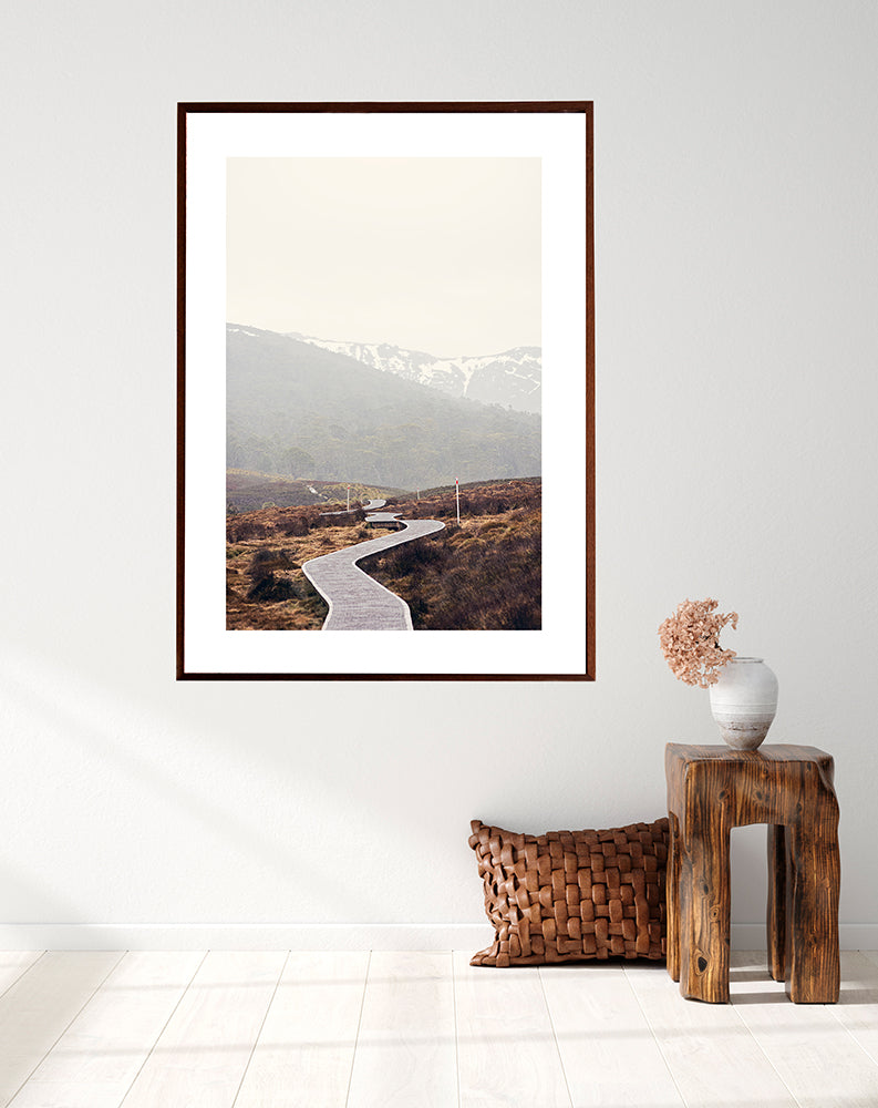 Cradle Mountain Wall art prints featuring the beautiful wilderness of Cradle Valley in Cradle Mountain National Park Tasmania and its boardwalk meandering through the button grass plains with the snowy mountains in the background by photographer Millie Brown