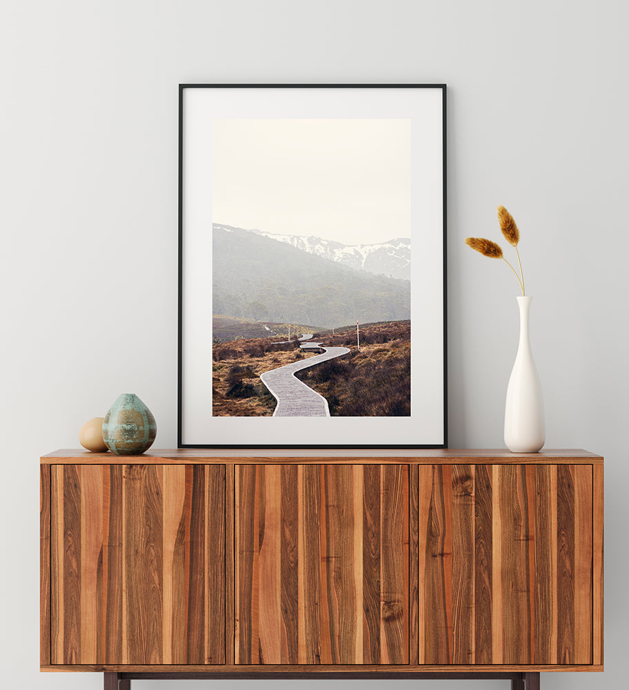 Cradle Mountain Photographic fine art prints  featuring the beautiful Tasmanian landscapes of Cradle Mountain National Park  with its walking trail  meandering through the button grass plains with the snowy mountains in the background by photographer Millie Brown