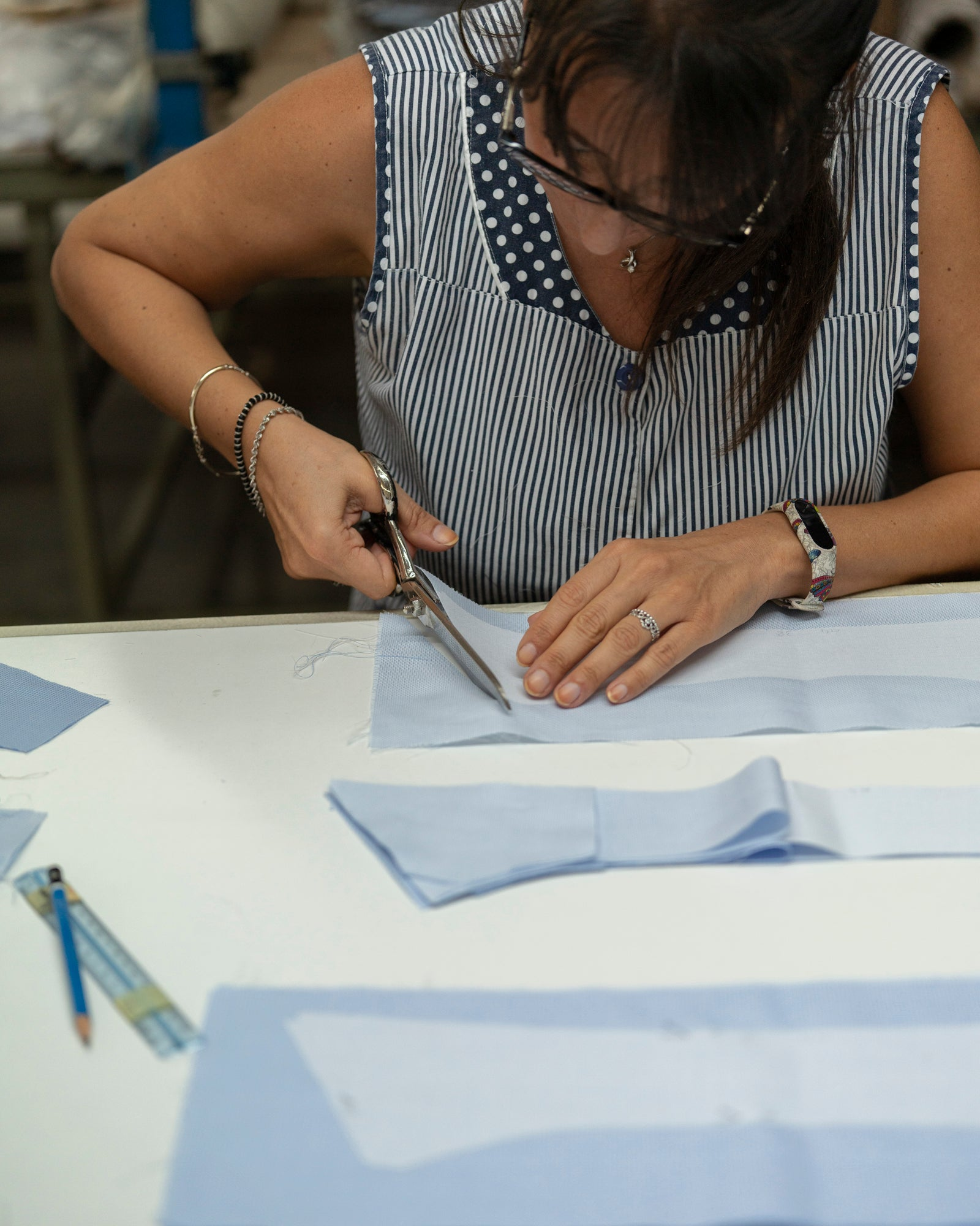 Handcutting the pattern of the shirt