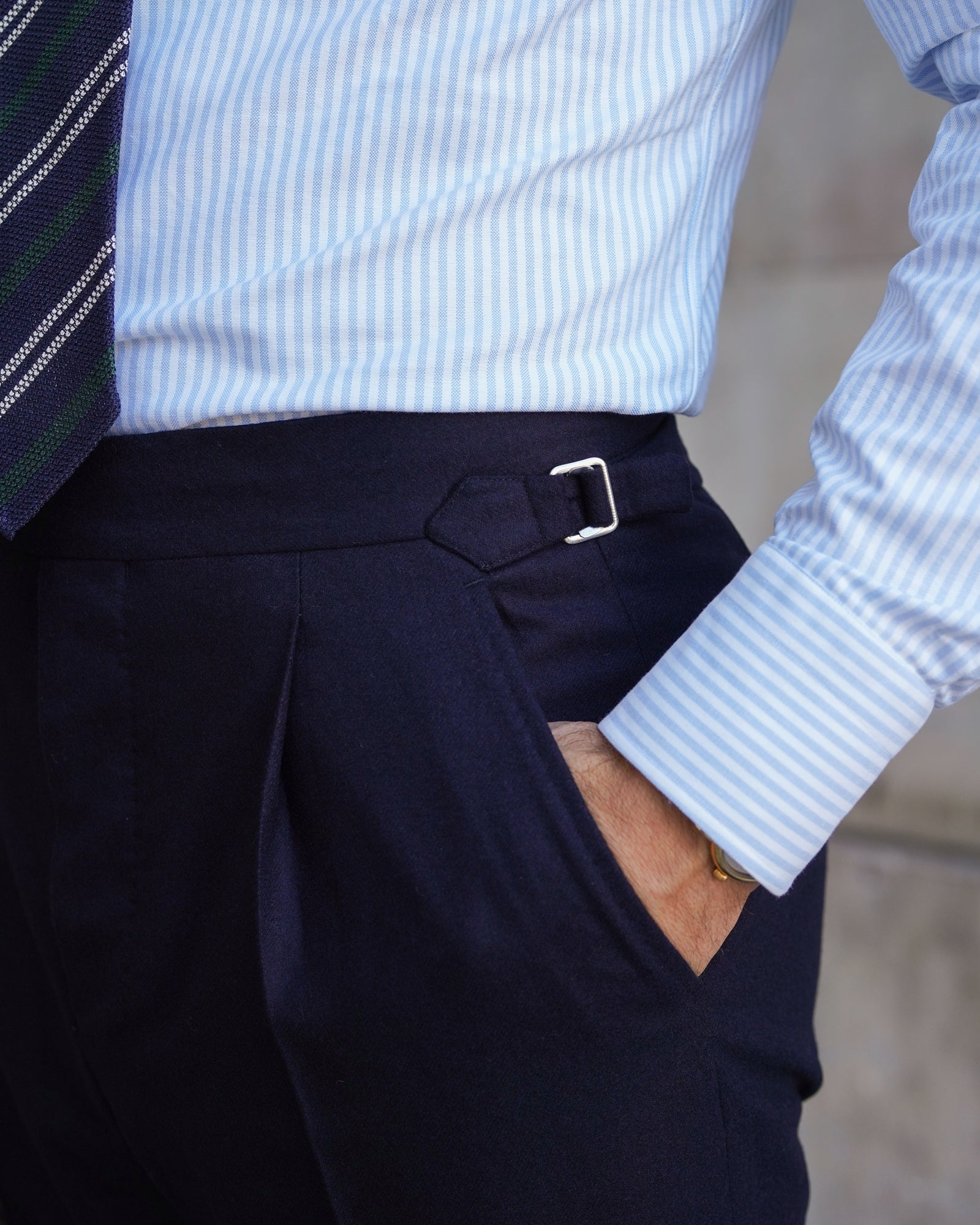 Navy flannel trousers with side-adjusters