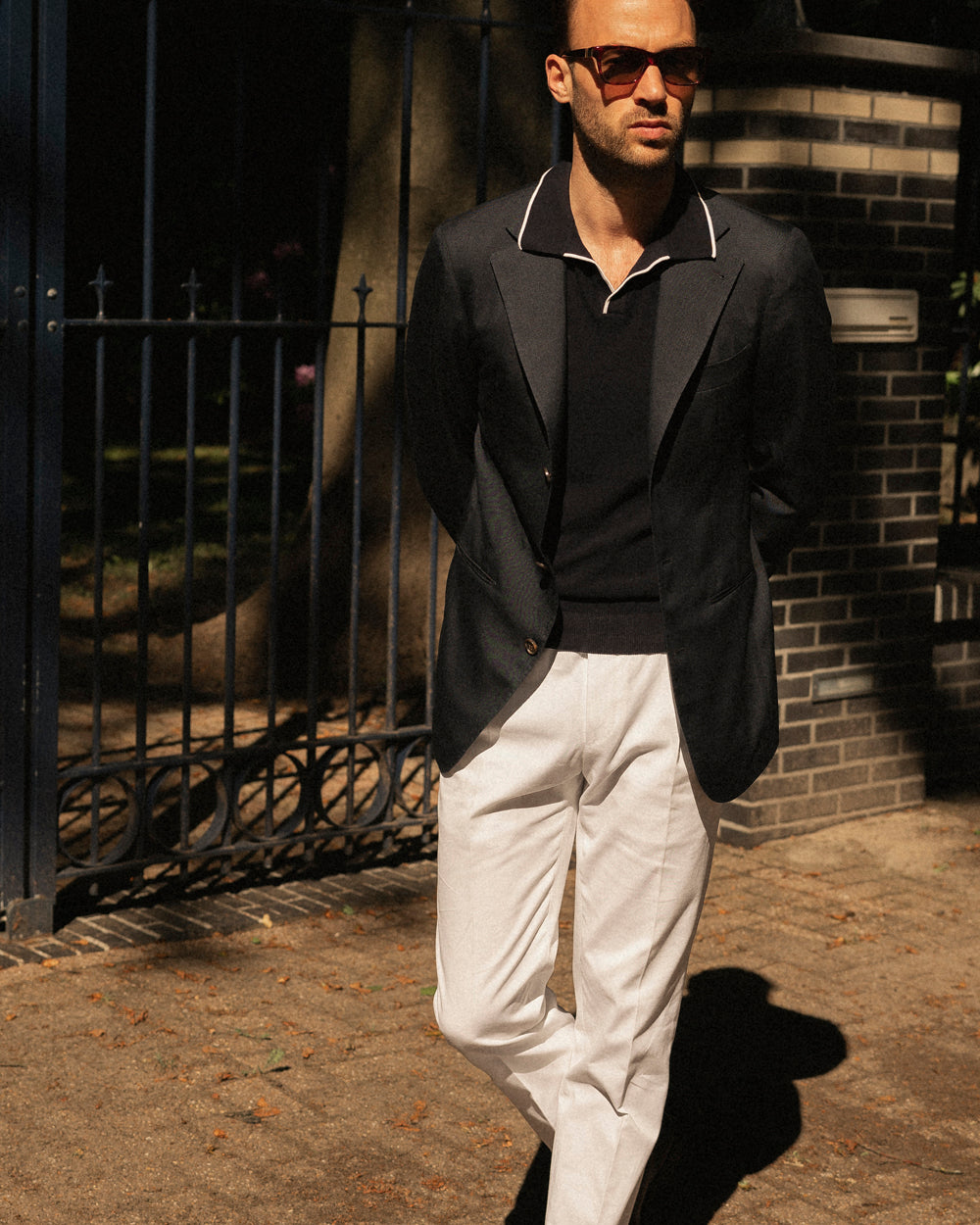 Navy dupioni silk sport jacket with white trousers and polo