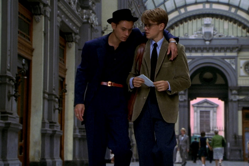Dickie Greenleaf wearing a navy suit in The Talented Mr Ripley