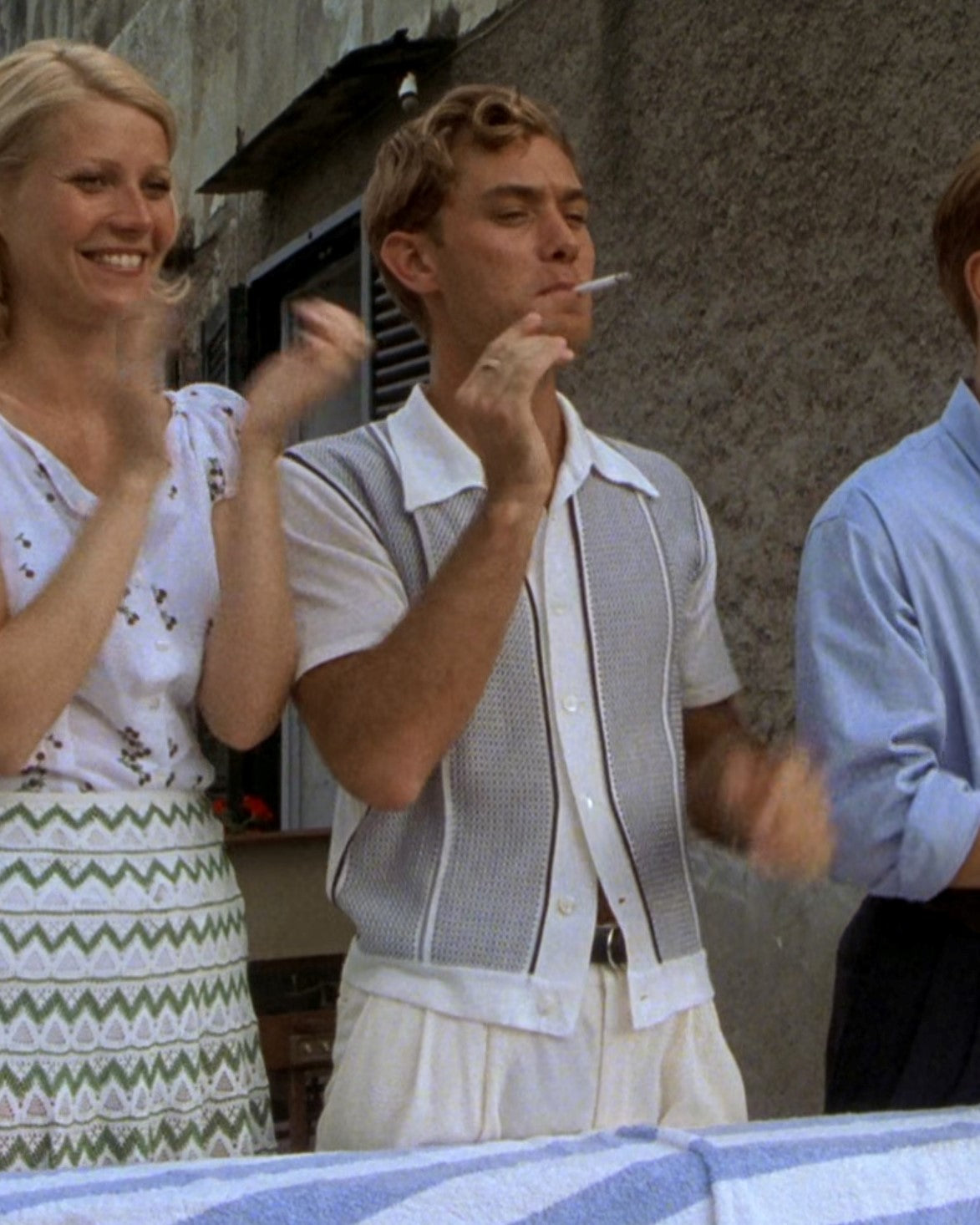 Jude Law wearing a knitted polo as Dickie Greenleaf in The Talented Mr Ripley