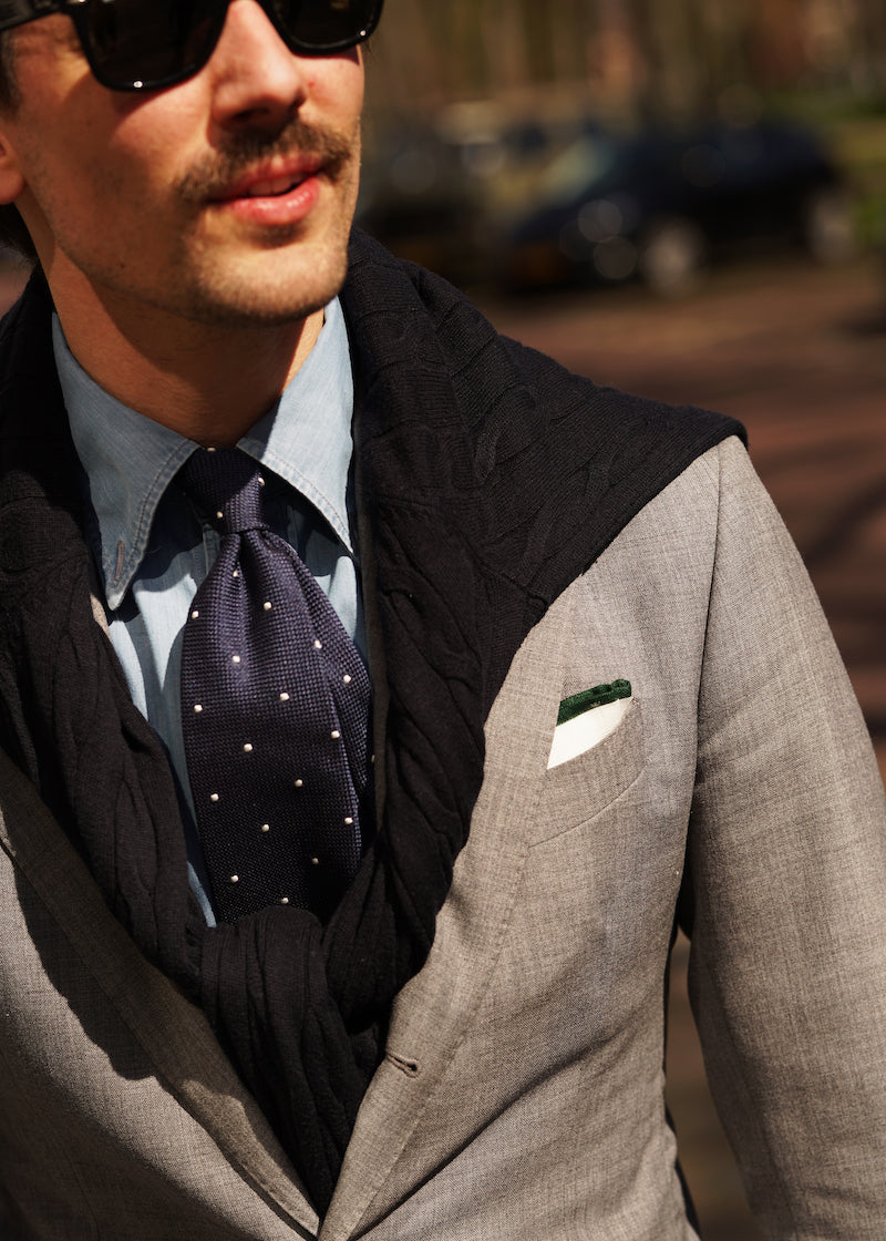 Garza fina grenadine tie worn with a grey suit