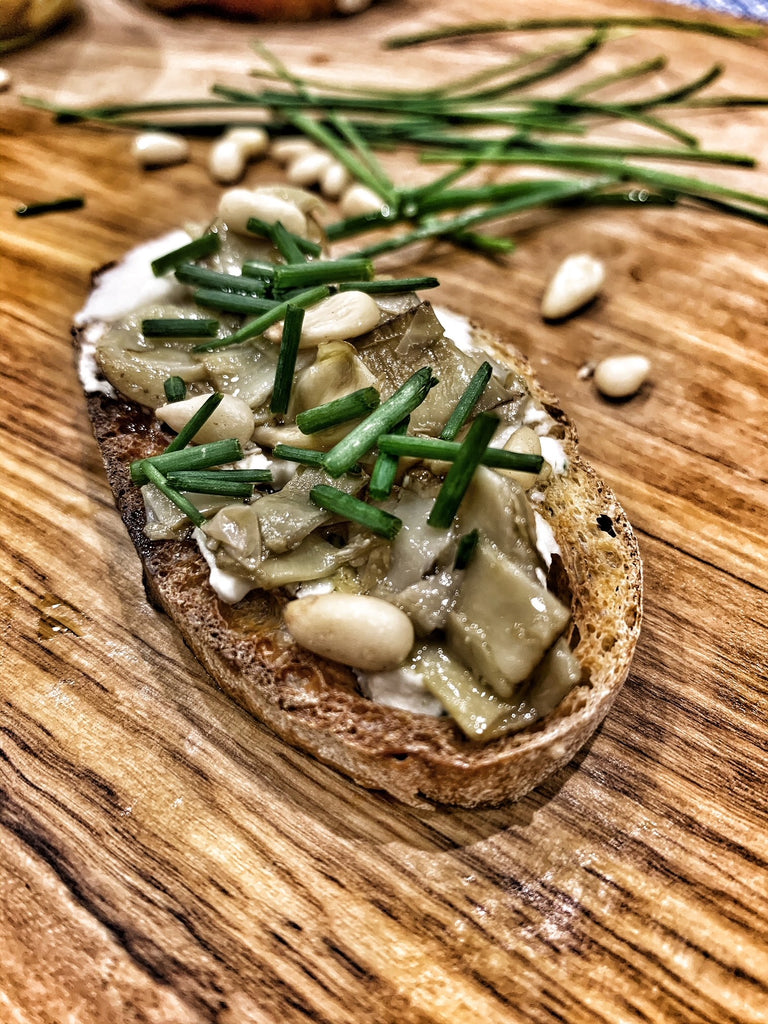 Artichoke Crostini with Cheese and Pine Nuts
