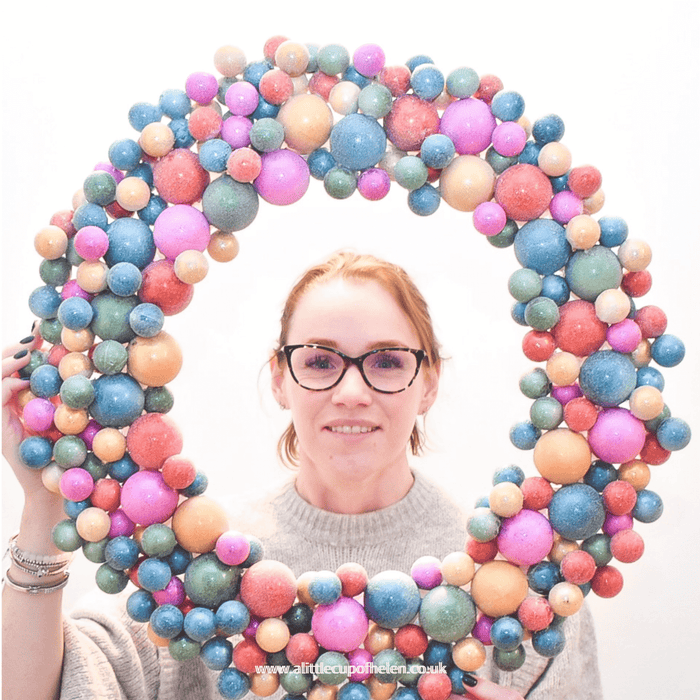 A beautiful large handmade bauble hoop featuring everything rainbow from our Online Creative Studio here at A Little Cup of Helen. The colours of the swirling baubles make it a statement decoration fit for a unicorn.  Approx 60cm overall width.
