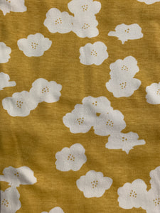 Yellow fabric with white flowers