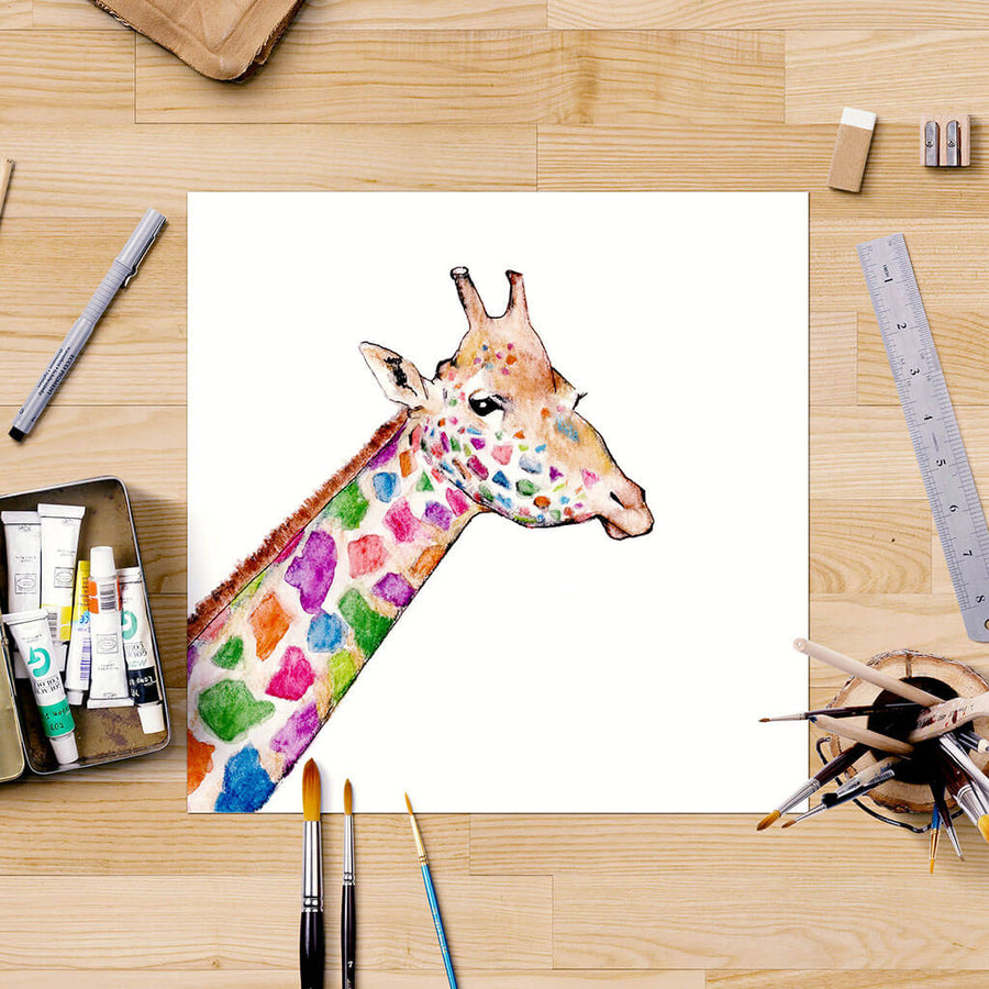 Giraffe painting on desk with art supplies