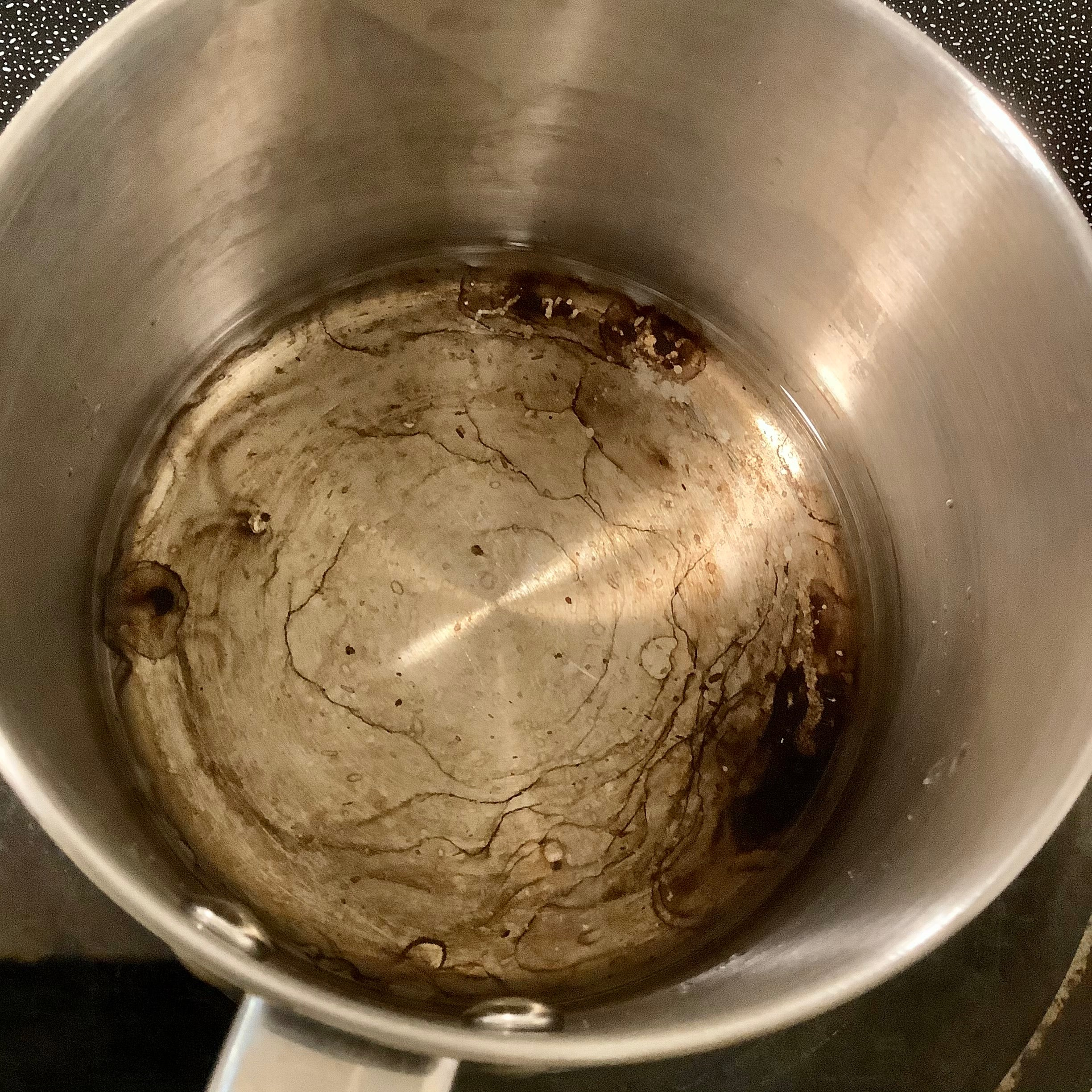 Stainless Steel Cooking Pot With Burnt Scorched Damage Before Cleaning