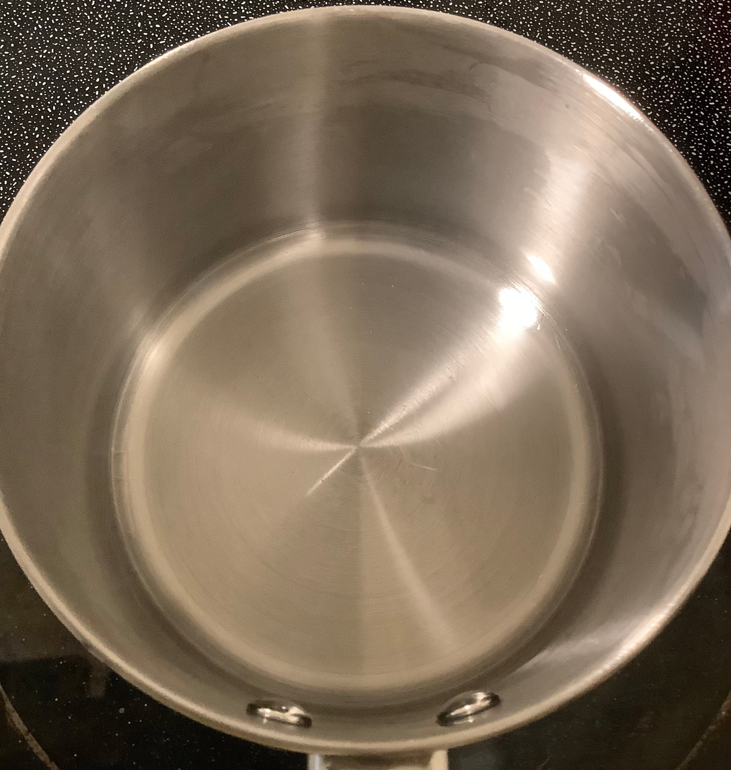 Stainless Steel Cooking Pot With Burnt Scorched Damage After Cleaning