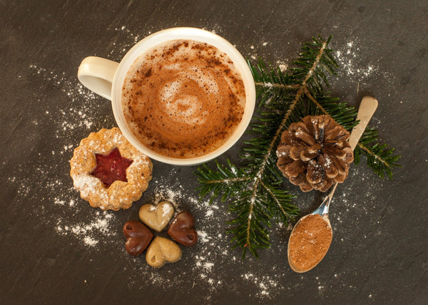 Mug Of Golden Cocoa Coffee With Spoonful Of Cocoa And Cookies Posed With Pine Cone