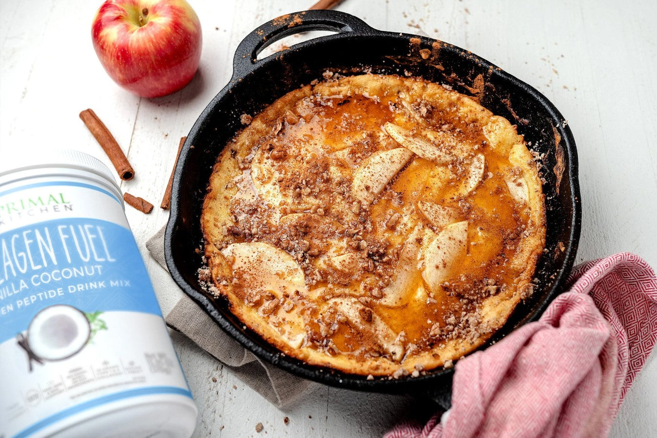 Cast Iron Skillet Of Apple Cinnamon Primal Pancakes With Red Delicious Apple And Cinnamon Sticks Made With Vanilla Coconut Collagen Peptide Powder Recipe Primal Kitchen