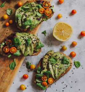 Avocado Herb And Mini Tomato Topped Bread Slices