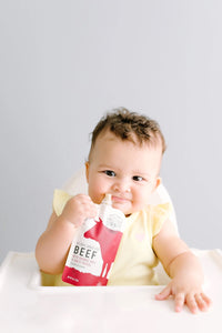 Baby Enjoying Grass Fed Beef Baby Food Serenity Kids Pouch
