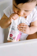 Load image into Gallery viewer, Baby Enjoying Organic Roots Baby Food Serenity Kids Pouch