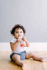 Load image into Gallery viewer, Baby Enjoying Wild Caught Salmon Baby Food Serenity Kids Pouch
