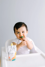 Load image into Gallery viewer, Baby Enjoying Organic Squashes Baby Food Serenity Kids Pouch