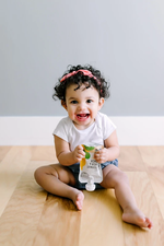 Load image into Gallery viewer, Baby Enjoying Organic Squash And Spinach Baby Food Serenity Kids Pouch