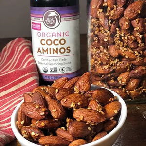 Big Tree Farms Coco Aminos With Dish Of Spiced Almonds