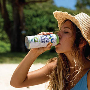 Woman In Summer Hat Outdoors Drinking C2O Pure Coconut Water With Coconut Pulp