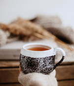 Load image into Gallery viewer, Hand Holding A Mug Of Hot Herbal Tea Outdoors