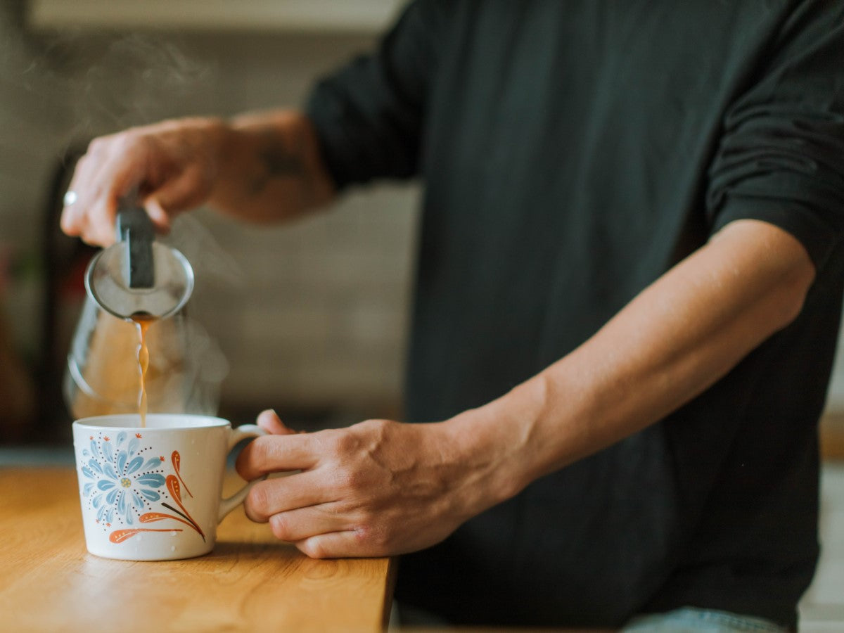 Man Pouring Cup Of Jim's French Roast Organic Coffee