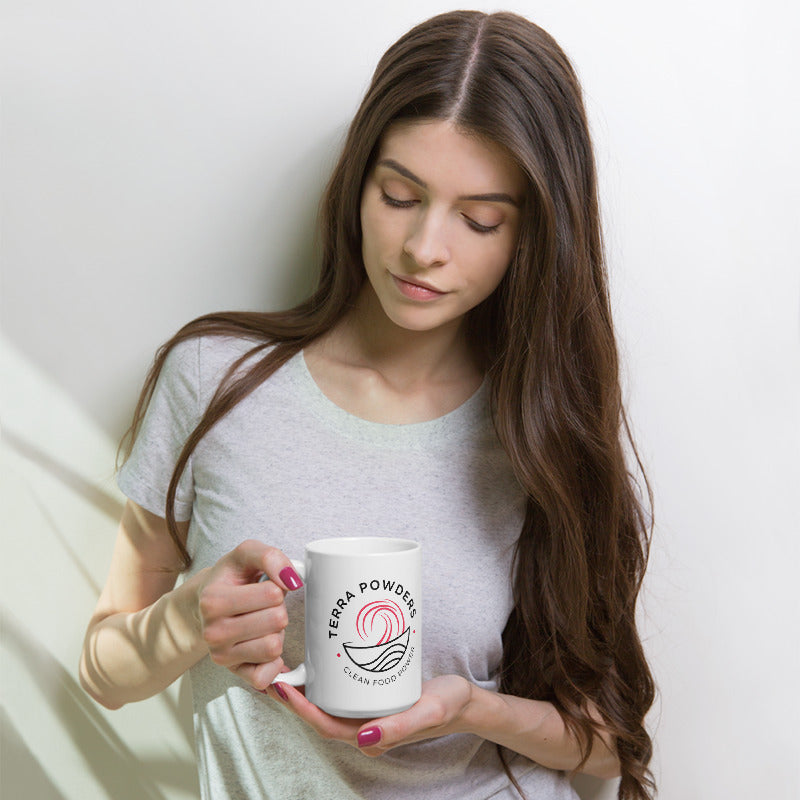 Woman Holding 15oz Mug With Dragon Berry Pink Terra Powders Logo