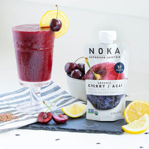 NOKA Superfood Smoothie Organic Cherry Acai Flax Garnished With Fresh Cherry And Lemon