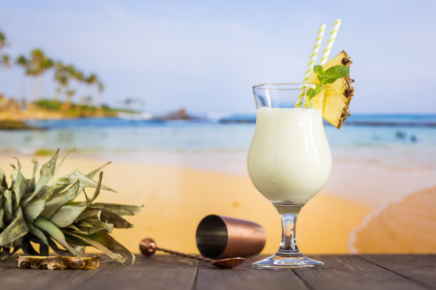 Coconut Water Tropical Pineapple Pina Colada Coconut Drink With Bar Tools And Beach Background