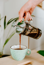 Load image into Gallery viewer, Pouring Dark Roast Italian Coffee From French Press Into Light Green Cup