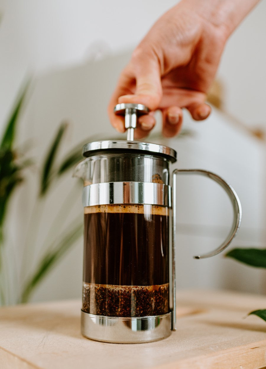 Pressing Down The French Press Coffee