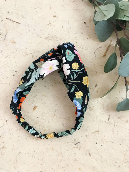 A vibrant floral twisted headband.